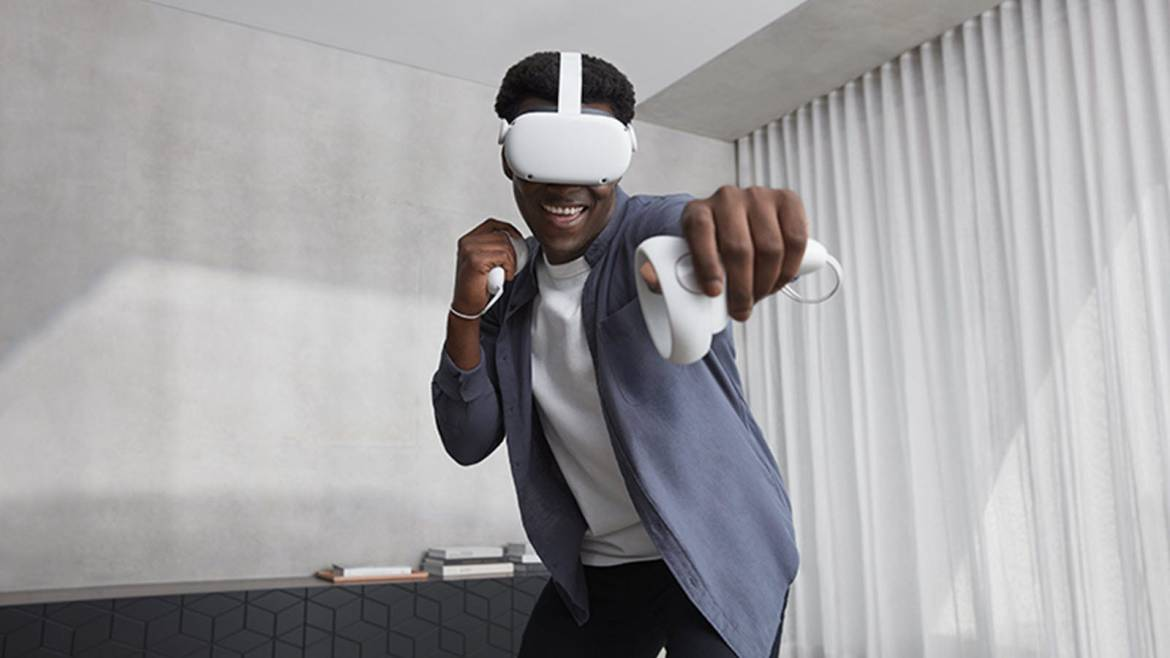 Man in a VR headset posing with his arm out.