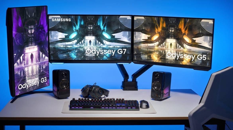 Three Samsung monitors on a desk.