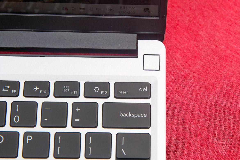 The fingerprint sensor on the Framework Laptop on top of a red tablecloth.