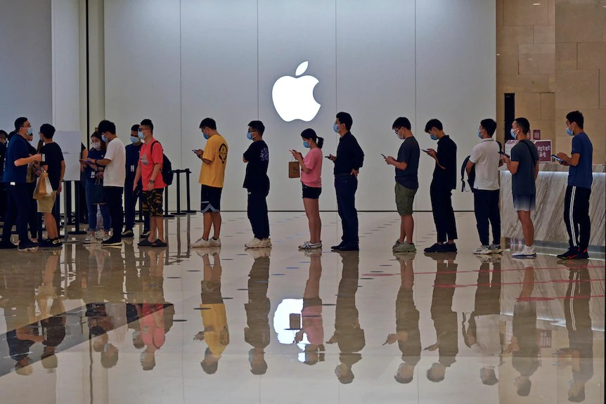 People line up at an Apple store in China.