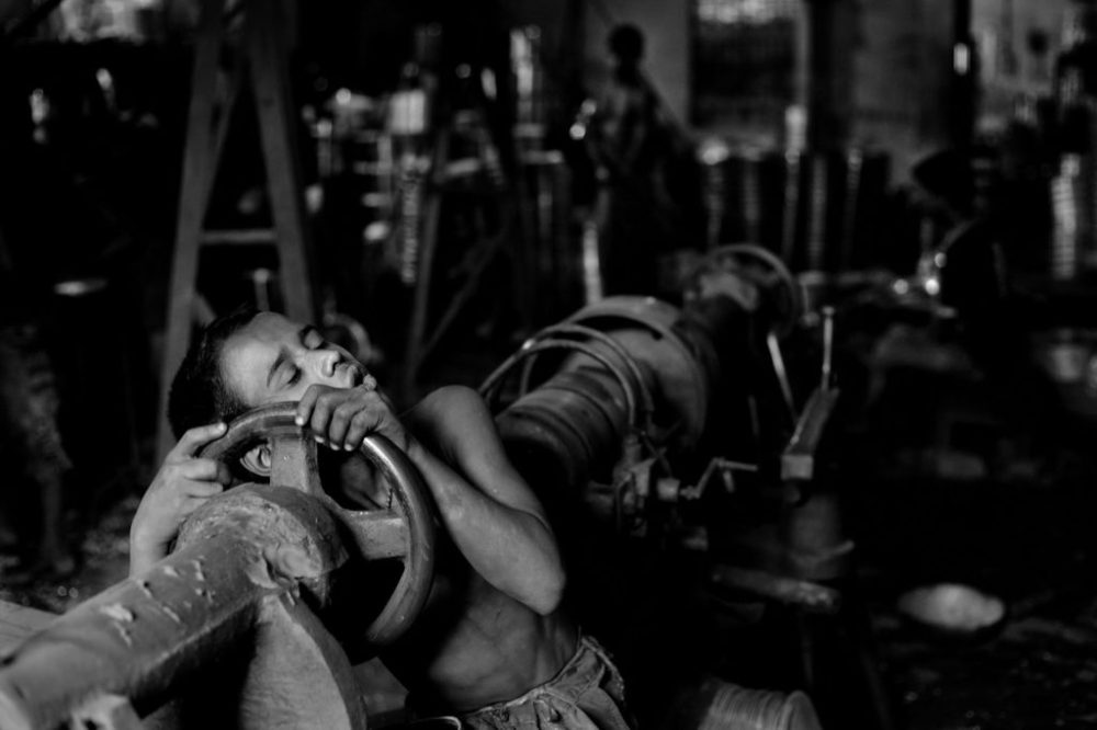 "© Md Shahnewaz Khan from the series ""Fallen Stars""; Shakil falls asleep on his tools after hard work at aluminum factory, Chittagong, Bangladesh, 2013"