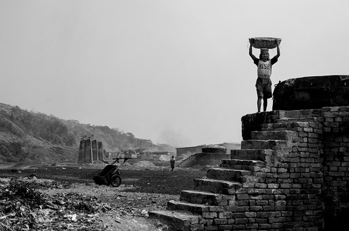 """© Debmalya Ray Choudhuri from the series """"Life in the Wasteland"""" - Md Azhar ,a casual day labourer ,a refugee from Bangladesh at work .Many of the people working and living here are originally from the other side of the border ,who lost their land and came here for work .They eventually end up being casual labourers working under daily labour contractors. The money they make is far beyond world minimum."""