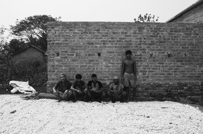 """© Debmalya Ray Choudhuri from the series """"Life in the Wasteland"""" - The labourers taking a rest from work .Most of them work relentlessly under extreme conditions for minimal wages and even the hands of the so called daily contractors are tied up as they are on a budget as well."""