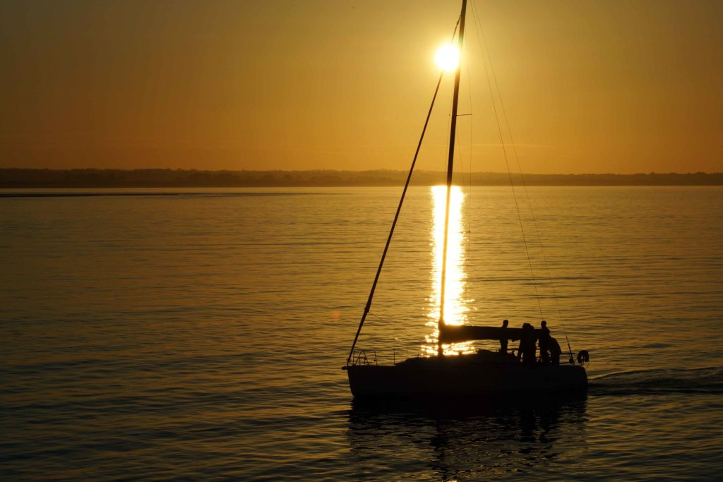Sailboat during sunset at Howth Harbor Ireland
