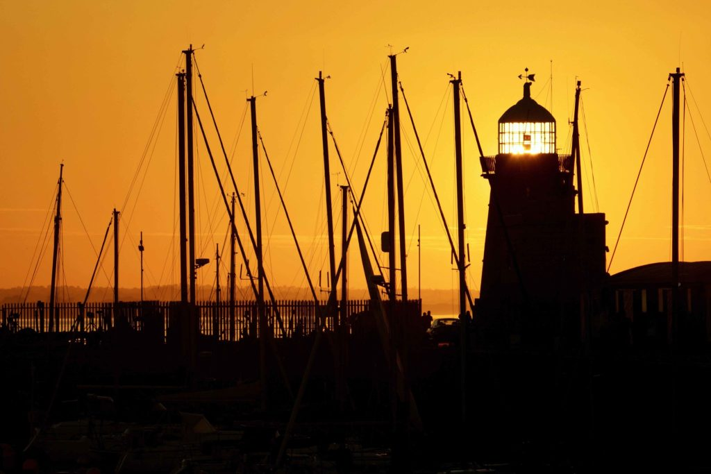 Sunset perfectly behind Howth Pier lighthouse