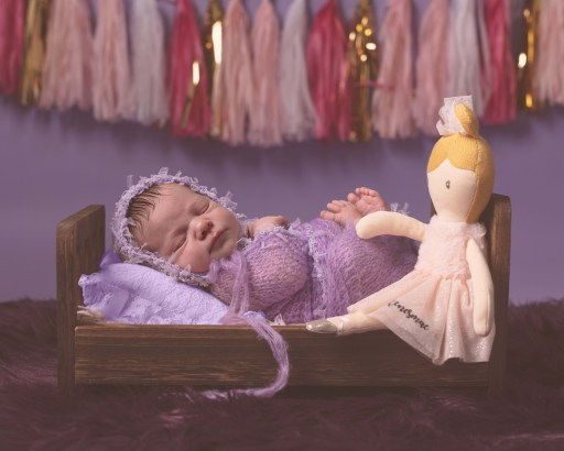 Newborn baby girl in bed