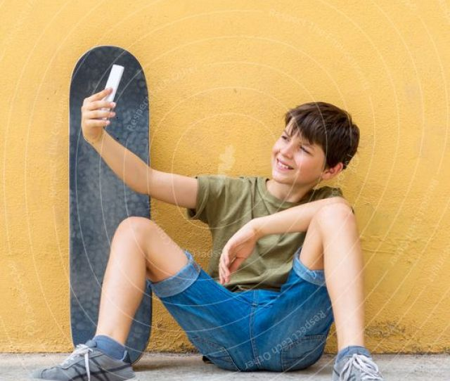 Young Teen Selfie With Skateboard Sitting On The Floor A Royalty Free Stock Photo From Photocase