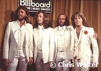 Photo of Bee Gees 1977  Barry Gibb, Robin Gibb, Maurice Gibb and Andy Gibb ay Billboard Music Awards<br>