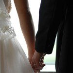 wedding photo hand in hand