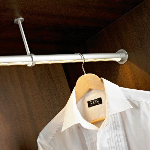 LED hanging rail inside wardrobe with white shirt on wooden hanger electrical photography