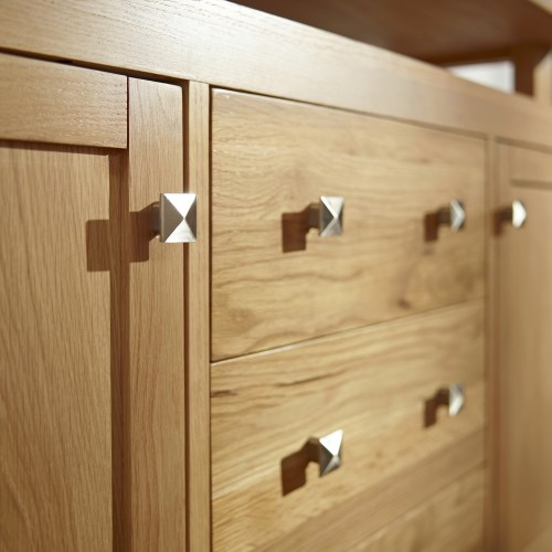 Close up of contemporary oak side board with brushed chrome square handles - Furniture photography