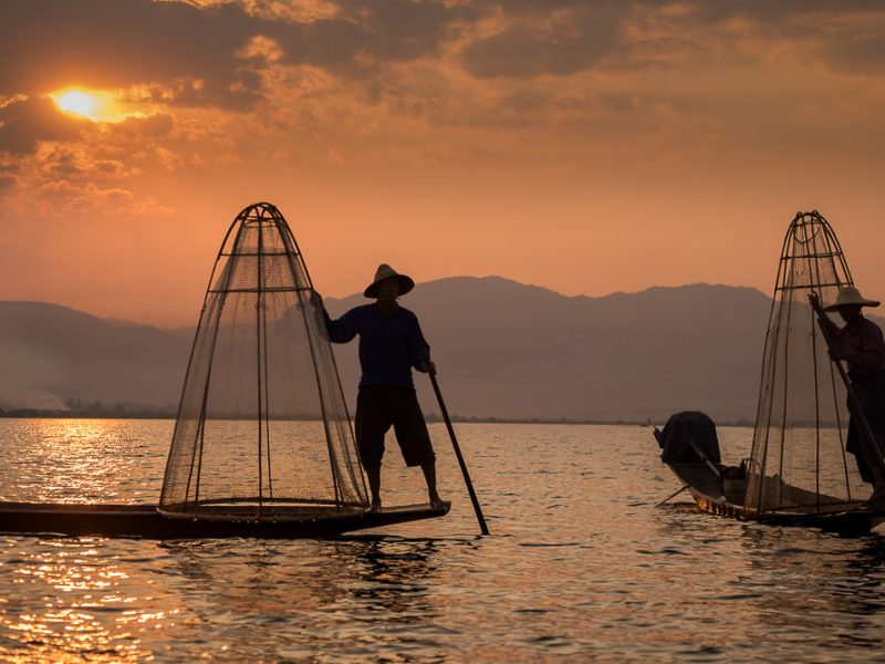fisherman at dawn inle lake, myanmar