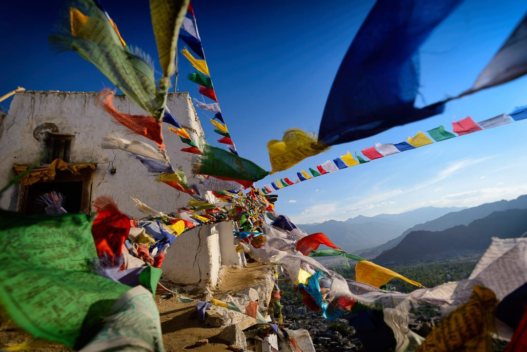 fluttering prayer flags over the sky at a leh gompa