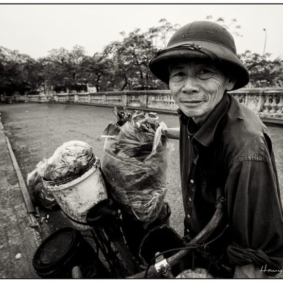 a man in a hat, north vietnam, bicycle