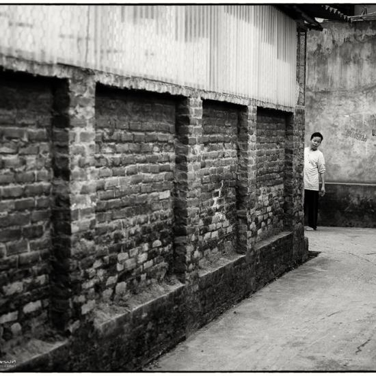 man and an alleyway in hanoi