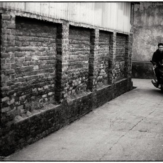 scooter in an alleyway hanoi
