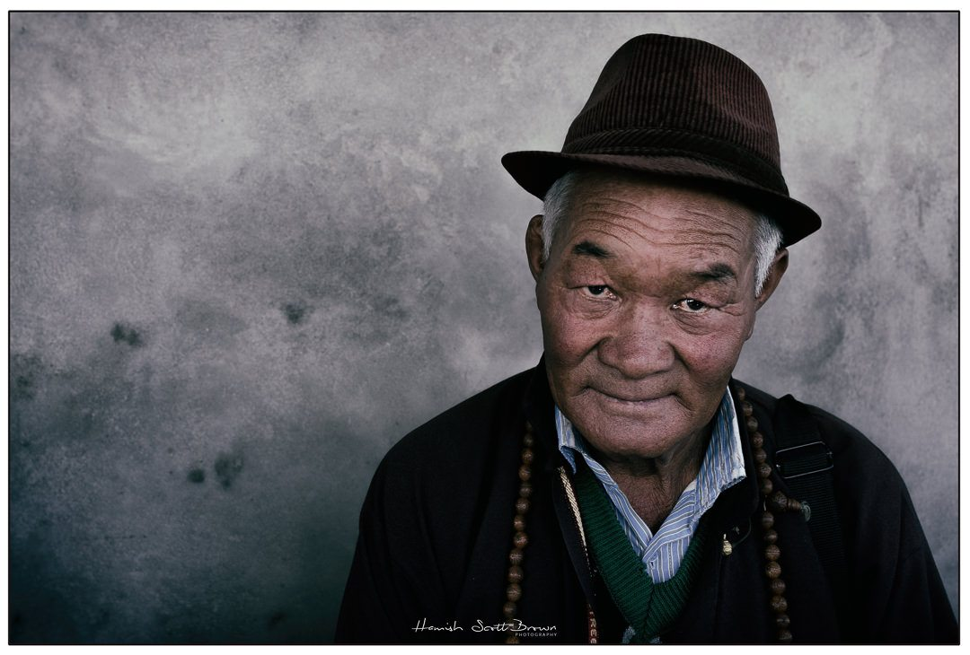 an old gentleman wearing a hat near Leh, Ladakh