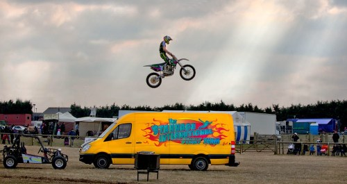 Motor bike jumping van - timing and aesthetics go together.