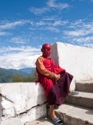 Young spiderman monk in Bhutan