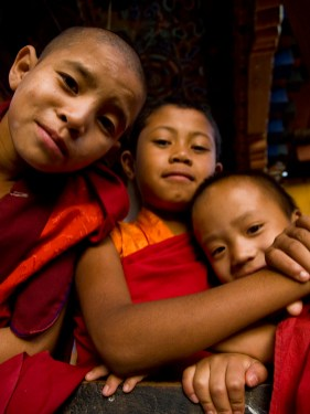 Young buddhist monks in front of the Divine Madman's fertility temple the Chimi Lhakhang