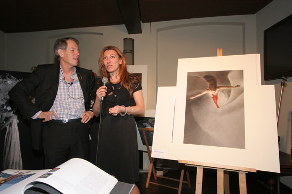 "Rosita with her picture ""Flying Down to Rio"" by Patrick Richmond Nicholas during Art and Run Photo Events"