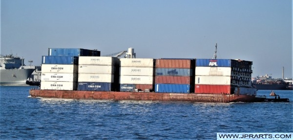 Barge laden with containers in the Port of New York and New Jersey