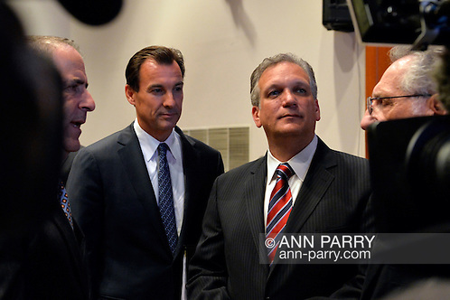 Old Westbury, New York, U.S. 8th October 2013. R-L, Republican EDWARD MANGANO, the Nassau County Executive, and Democrat THOMAS SUOZZI, the former Nassau County Executive, are approached by supporters and media before the two face each other in a debate hosted by the Nassau County Village Officials Association, representing 64 incorporated villages with 450,000 residents, as the opponents face a rematch in the 2013 November elections.  (Ann Parry/Ann Parry, ann-parry.com)