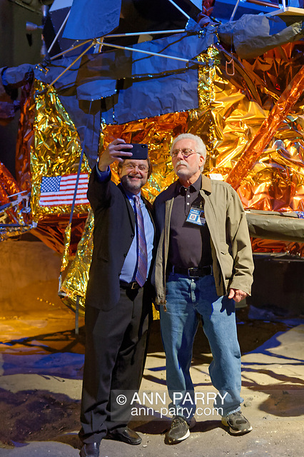 Garden City, New York, USA. May 23, 2019. At left, author ANDREW CHAIKIN takes a selfie with ALAN CONTESSA, who worked on the real Apollo 11 lunar module, as they stand in front of the genuine Lunar Module LM-13, built for cancelled Apollo 18 mission.
