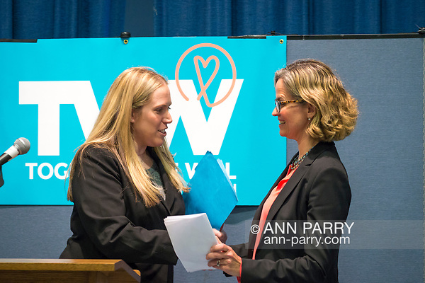 Wyandanch, New York, USA. March 26, 2017. L-R, SUE MOLLER, an administrator of Together We Will Long Island, introduces and shakes hands with LAURA CURRAN, Nassau County Legislator (Dem. - District 5), who is about to speak at Politics 101 event, the first of series of activist workshops for members of TWW LI, the Long Island affiliate of national Together We Will. Curran is a Democratic candidate for Nassau County Supervisor. (Ann Parry/Ann Parry, ann-parry.com)