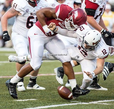 Sep 20, 2014; Fayetteville, AR, USA; Arkansas Razorbacks defensive end Trey Flowers (86) hits Northern Illinois University Huskies quarterback Drew Hare (12) and causes a fumble during the first half of a game at Donald W. Reynolds Razorback Stadium. Mandatory Credit: Beth Hall-USA TODAY Sports (Beth Hall/Beth Hall-USA TODAY Sports)