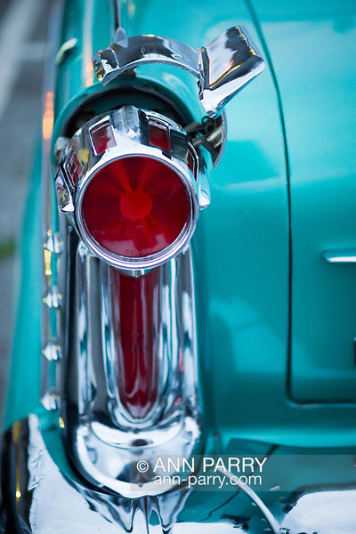 Bellmore, New York, USA. 11th August 2017. At Bellmore Friday Night Car Show, Frank Martocci, of Bellmore, is owner of Bugmobile, owner of green Oldsmobile, 1958, with left taillight shown in detail where chrome piece is swung open to reveal opening the gas is put in tank. (Ann Parry/Ann Parry, ann-parry.com)