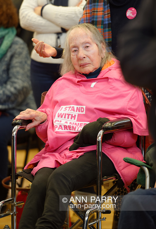 "Westbury, New York, USA. January 15, 2017. Sitting in wheelchair, PEARL BERGER, 97, of Amityville, who has breast cancer and Parkinson's Disease, has an ""I STAND WITH PLANNED PARENTHOOD"" pink shirt draped on her chest, at the ""Our First Stand"" Rally against Republicans repealing the Affordable Care Act, ACA, taking millions of people off health insurance, making massive cuts to Medicaid, and defunding Planned Parenthood. (Ann Parry/Ann Parry, ann-parry.com)"