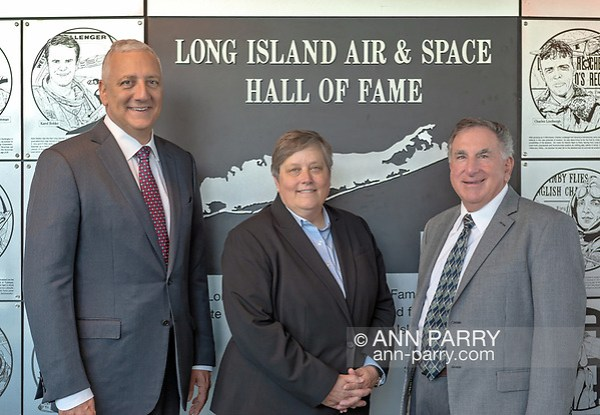 Garden City, NY, USA. June 21, 2018. Astronaut MIKE MASSIMINO, DEBORAH HENLEY, and LOUIS MANCUSO pose at Long Island Air & Space Hall of Fame at Cradle of Aviation Museum. (© 2018 Ann Parry/Ann-Parry.com)