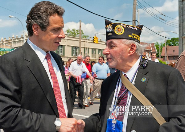 MAY 30, 2011 - Little Neck, New York, U.S. - New York Governor ANDREW CUOMO stops to speak and shake hands with MARK KOPPELMAN, a U.S. Army veteran wearing US Press Corp Photographer Pass, of Oakland Gardens, during Little Neck-Douglaston Memorial Day Parade, on Northern Boulevard on May 30, 2011. (Ann Parry/Ann Parry, ann-parry.com)