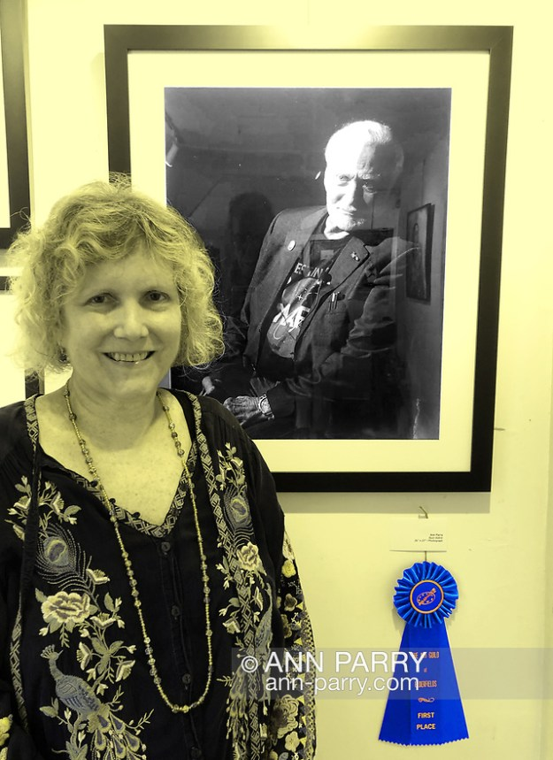 Manhasset, New York, U.S., September 8, 2019. Photographer Ann Parry poses by her Buzz Aldrin portrait, 1st Place winner of The Art Guild Portrait exhibit and competition. (Ann Parry/Ann Parry, ann-parry.com)
