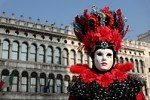 Woman dressed in traditional mask and costume for Venice Carnival standing in Piazza San Marco, Venice, Veneto, Italy (Brad Mitchell Photography)