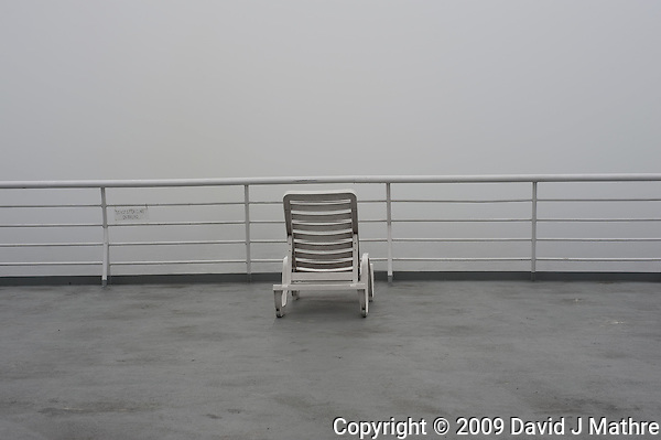 Lone Deck Chair on Misty Morning. Solarium Deck on the M/V Columbia Alaska Marine Highway Between Bellingham, Washington and Haines, Alaska. Image taken with a Nikon D3 and 50mm f/1.4 lens (ISO 200, 50 mm, f/8, 1/1000 sec). (David J Mathre)