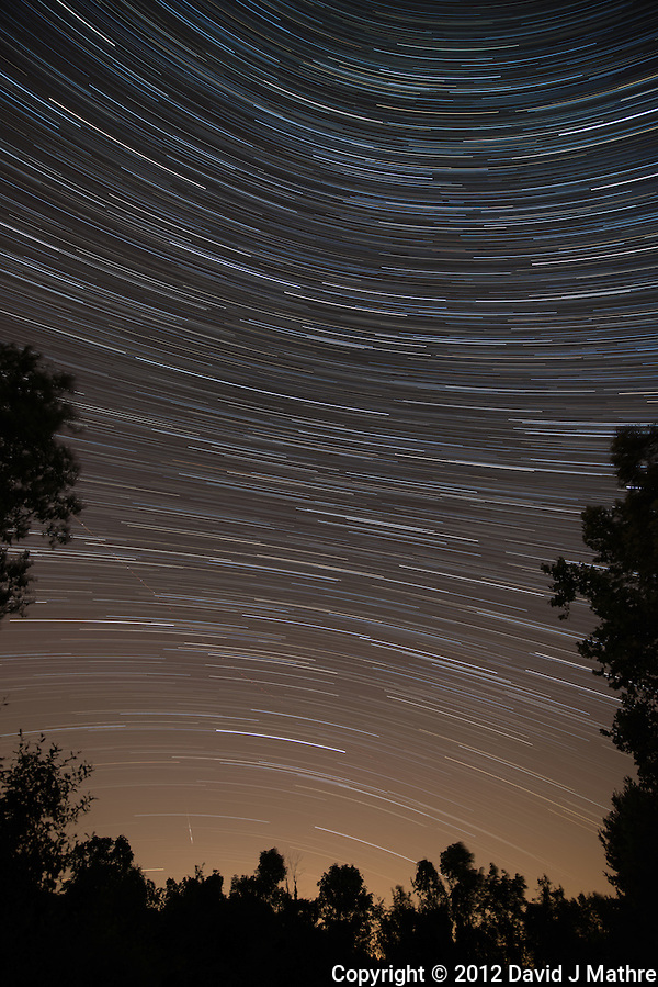 Startrails Looking For Perseid Meteors. Summer Night Sky in New Jersey. Composite of images taken between 0200h and 0313h with a Nikon D800 and 14-24 mm f/2.8 lens (ISO 400, 14 mm, f/2.8, 30 sec) using the Startrails program. (David J Mathre)