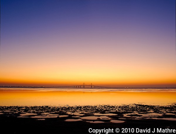 Sunshine Skyway Bridge Panorama at Dawn from Fort Desoto Park. St. Petersburg, Florida. Composite of 3 vertical images taken with an Nikon D3s and 45 mm f/2.8 PC-E lens (ISO 200, f/11, 0.5 sec). Images processed with DxO, AutoPano Giga, Photoshop CS5, and Topaz Define. (David J Mathre)