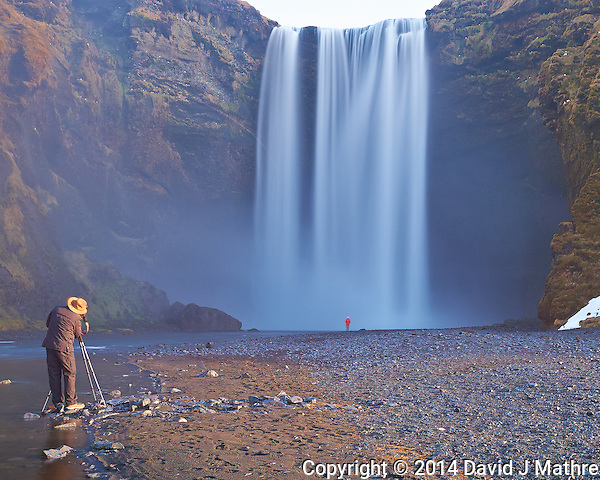 Skogarfoss, a Waterfall in Southern Iceland. Only another photographer setting up his image (and his very patient wife in red at the base of the waterfall) would be still enough for a 10 second exposure. Image taken with a Nikon Df camera and 24 mm f/1.4G lens + 10 stop Singh-Ray Neutral density filter (ISO 800, 24 mm, f/8, 10 sec). (David J Mathre)