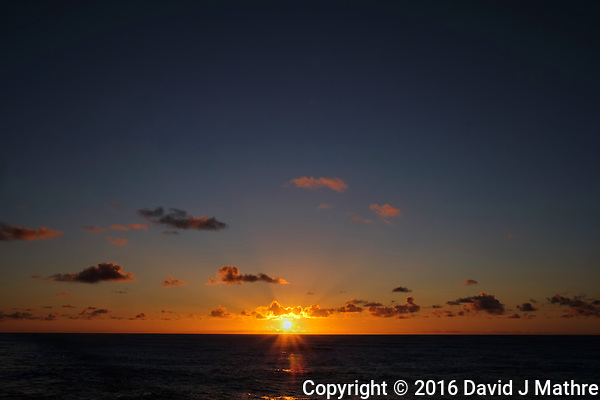 Sunrise from the deck of the MV World Odyssey while traveling across the Pacific Ocean. Image taken with a Fuji X-T1 camera and 23 mm f/1.4 lens (ISO 200, 23 mm, f/16, 1/250 sec). Images processed with Capture One Pro. (David J Mathre)