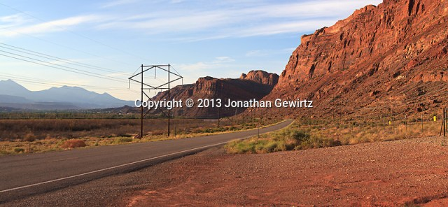 Panoramic view of Utah Route 279/Potash Road at the entrance of the scenic Colorado River gorge in Moab, Utah. The Lasal Mountains are visible in the distant background. (© 2013 Jonathan Gewirtz / jonathan@gewirtz.net)