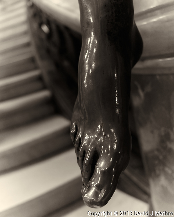 Bronze Foot of the Stairway. Paris Opera House. Image taken with a Leica X2 camera (ISO 800, 24 mm, f/2.8, 1/30 sec). Capture One Pro 7 conversion to B&W. (Photographer)