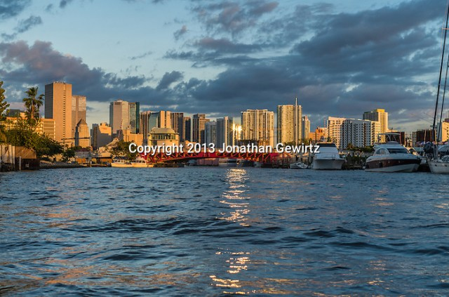Boats and infrastructure on the Miami River looking east around sunset in the direction of downtown Miami, Florida. (Jonathan.Gewirtz@gmail.com)