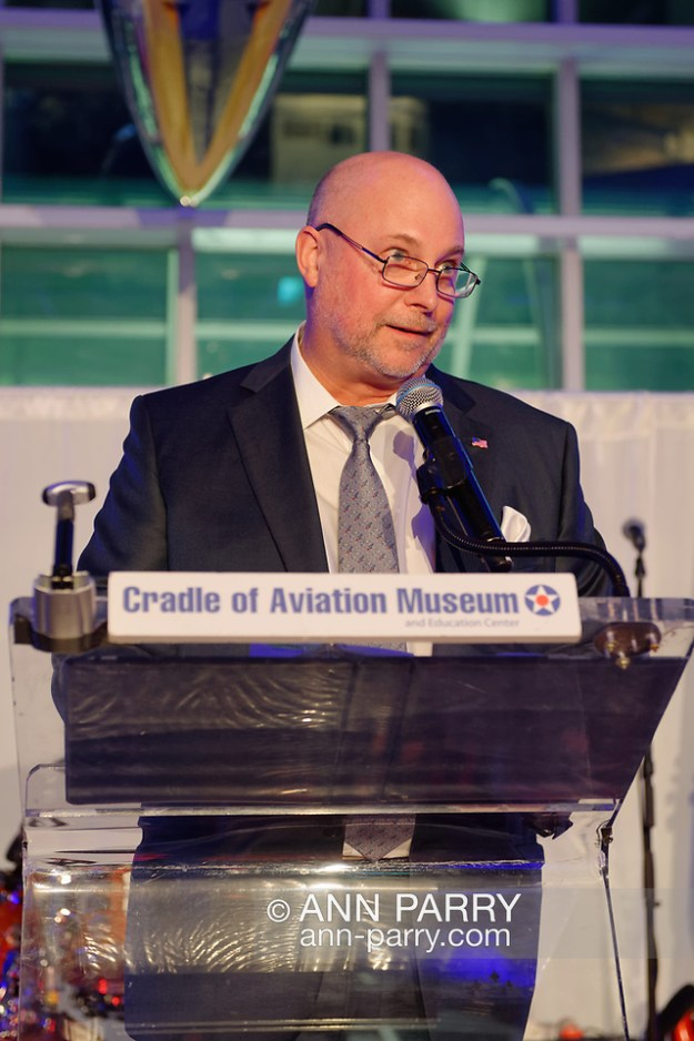 Garden City, New York, U.S. November 14, 2019. PERRY YOUNGWALL, CEO and President of Transaero, Inc, speaks at podium about receiving the Leroy R. Grumman Award at the 17th Annual Cradle of Aviation Museum Air and Space Gala. (© 2019 Ann Parry/Ann-Parry.com)