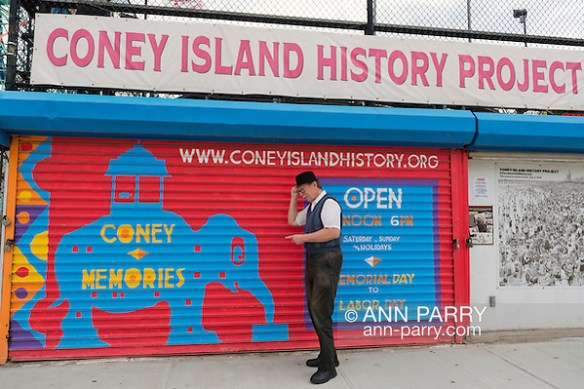 Brooklyn, New York, USA. 10th August 2013. BOB STUHMER, a member of AMICA, poses under the Coney Island History Project banner over the booth where visitors can get information about world famous neighborhood, beach and boardwalk and amusement park, during 3rd Annual Coney Island History Day celebration. (© 2013 Ann Parry/Ann Parry, ann-parry.com)