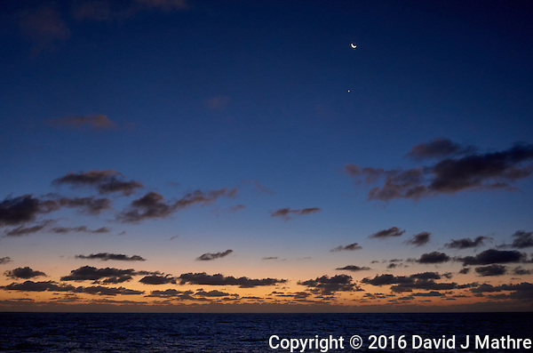 Moon, Venus, and clouds over the Pacific Ocean at dawn from the deck of the MV World Odyssey. Semester at Sea, 2016 Spring Semester Voyage. Day 2 of 102. Image taken with a Leica T camera and 23 mm f/2 lens (ISO 1250, 23 mm, f/2, 1/80 sec). (David J Mathre)