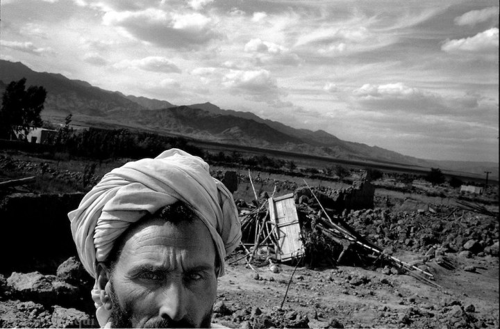 kalooshah, south waziristan, april 2004: mir abbas khan sits outside the remains of his family home, destroyed by pakistan army bulldozers. the army has destroyed dozens of homes in this area of people it claims were harboring al qaeda fighters and collaborators. many innocent civilians have lost their homes, belongings and means of livelihood as a consequence. (asim rafiqui)