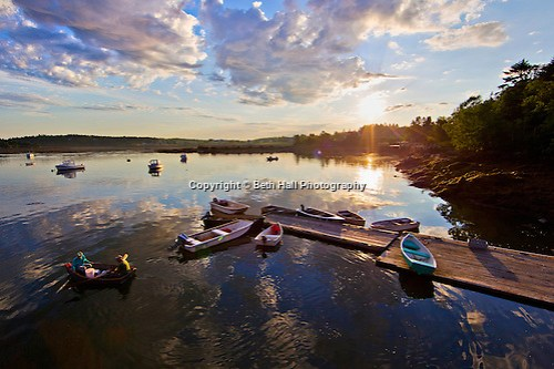 Lobstermen head to their lobster boat as the sun rises in Addison, Maine. (Beth Hall)
