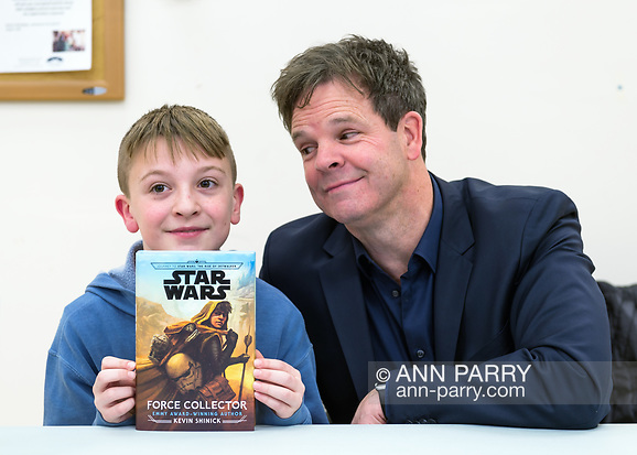 Merrick, New York, U.S. December 20, 2019. L-R, JAKE LEFEBURE, 10, of West Babylon, holding signed book, and author KEVIN SHINICK, 50, strike funny pose at book signing for Shinick's STAR WARS: FORCE COLLECTOR at North Merrick Library on Nassau County Force Collector Day. Author Shinick named home planet of Karr Nuq Sin, the main character of this canon Star Wars young adult novel, MEROKIA in honor of Merokee tribe who settled his Merrick hometown on Long Island. (© 2019 Ann Parry/Ann-Parry.com)